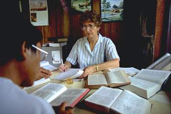 OMF missionary Rowland Bell and Thai national Miss Wasana working together on a Thai manuscript. One of the major decisions for Bible translators is the choice of the name for God which will convey His holiness, omnipotence and supremacy without any animistic, idolatrous or evolutionary associations.