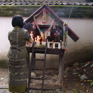 Offering of food and drink on a spirit shrine at a local home