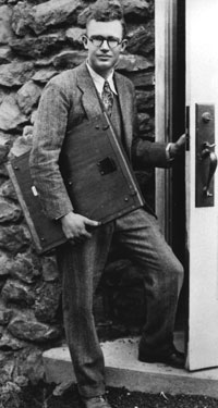 Clyde W. Tombaugh at the door of the Pluto discovery  telescope, Lowell Observatory, Arizona.