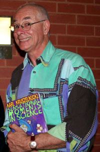Dr Karl Kruszelnicki, garishly attired, smiling engagingly, and toting a copy of his book Sensational Moments in Science.