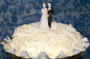 A husband and wife replica atop a wedding cake