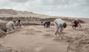 paleontological team excavating the Megatherium footprints in the Voyage movie