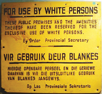 A typical sign of the apartheid era in a South African public space, probably a Durban beach.