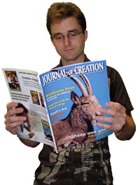 Person reading Journal of Creation