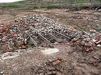Building foundations and unwanted rubble from 'old Adaminaby' buildings.