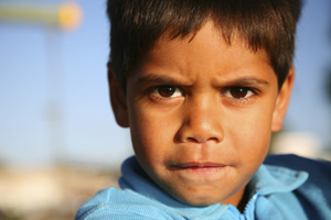 photo of a frowning aboriginal boy