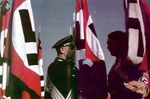 Hitler and the Nazi blood flag at 1938 Nuremburg rally.