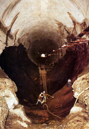 Photo of the damaged Glen Canyon Dam tunnel spillway