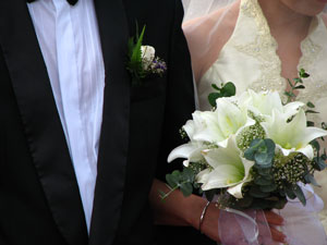 Wedding participants arm in arm