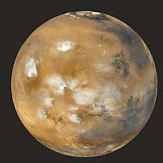 The planet Mars, like Earth, has clouds in its atmosphere and a deposit of ice at its north pole. But unlike Earth, Mars has no liquid water on its surface. The rustlike color of Mars comes from the large amount of iron in the planet's soil.