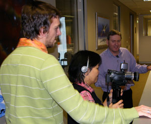 CMI's Jason Jamieson gives Mrs Esther Catchpoole some tips on using a home video camera.