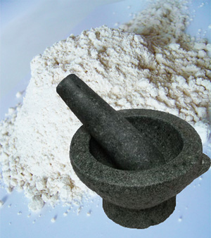 Stone mortar and pestle and flour