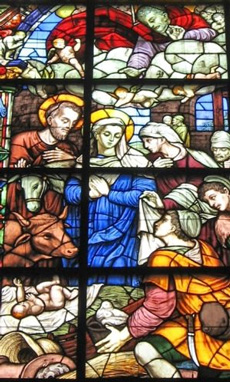 A stained glass window nativity scene
