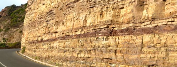 Maroon mudstone beds and buff sandstone beds alongside Chapman's Peak Drive south of Cape Town.