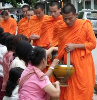These ladies believe they can earn good karma by giving food each day to Buddhist monks.