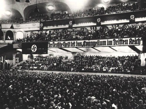 The so-called 'German Christian Movement' desired to achieve absolute organizational and ideological conformity between the Protestant church and the National Socialist state. The banner reads: The German Christian reads the 'Gospel in the Third Reich'