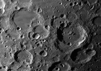 Multiple impact site near Crater Stöfler, including Maurolycus and Heraclitus.