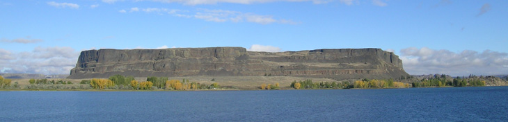 Figure 5. Steamboat Rock, a 275 m high erosional remnant of basalt lava in the Upper Grand Coulee, Washington. The lava around Steamboat Rock was eroded in a few days by the lake Missoula flood.
