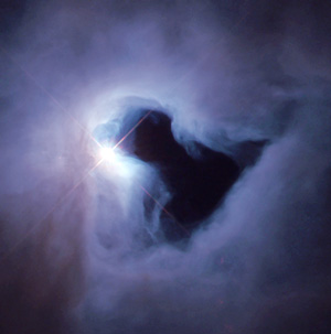 A Bok globule in the reflection nebula NGC 1999 in Orion; star left of center is V380 Orionis, 3.5 times solar mass, and is responsible for the light which the nebula reflects (NASA-HST). In the accretion theory, the nebula is supposed to be material collapsing into the star.
