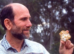 Jack Lange holding gold-bearing quartz.