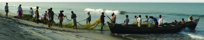 fishermen on beach with nets and boat